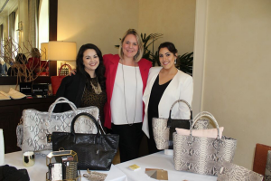 3 women and handbags